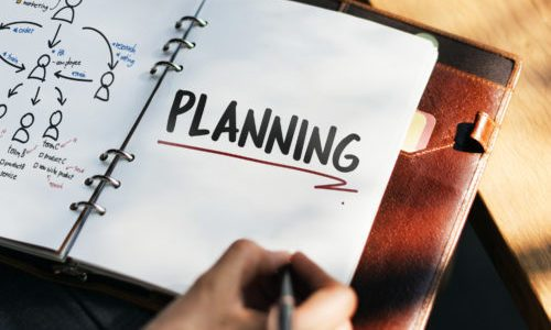 Woman writing and planning business strategy